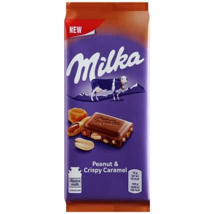 Шоколад Milka Молочный с арахисом и кусочками хрустящей карамели 90г