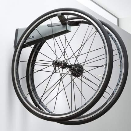 Крепежная система Tacx для подвешивания колес на стену